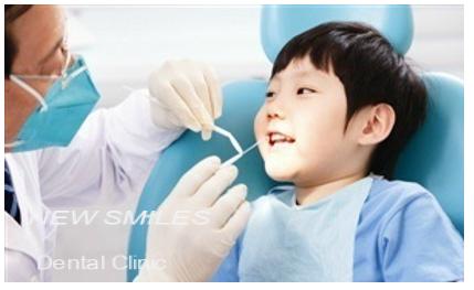 Cách nhổ răng sữa cho trẻ em không đau